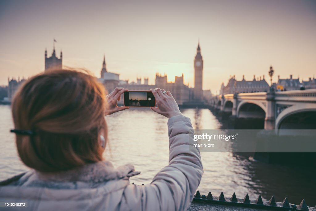 Tourist woman in England taking photos : Stock Photo
