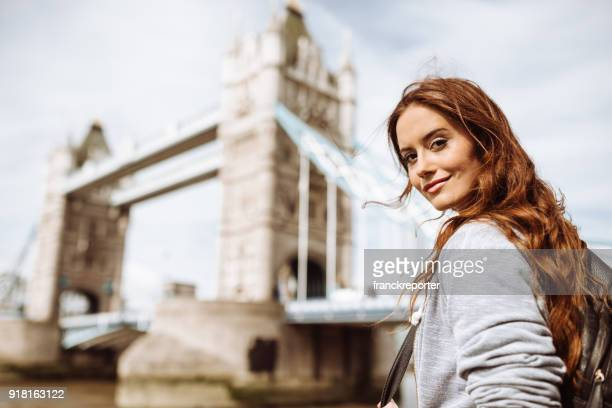 tourist woman in london at tower bridge