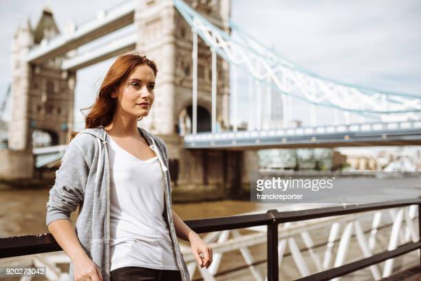tourist woman in london at tower bridge
