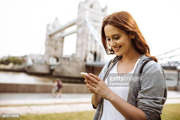 tourist woman in london on the phone