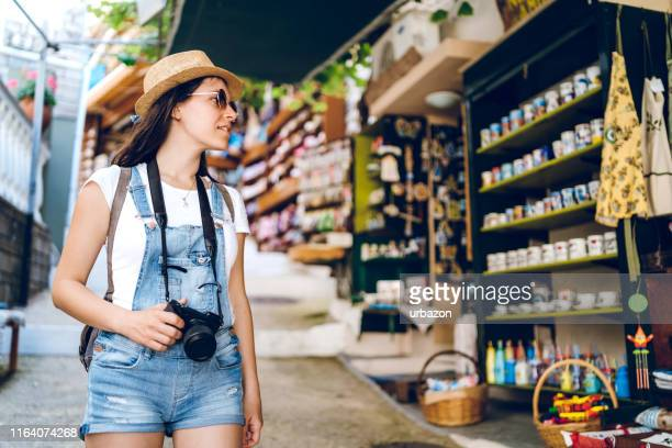 tourist woman in street market - epirus greece stock pictures, royalty-free photos & images