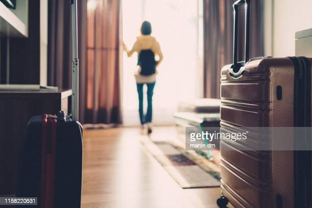 tourist woman just arriving in the hotel room - latium stock pictures, royalty-free photos & images
