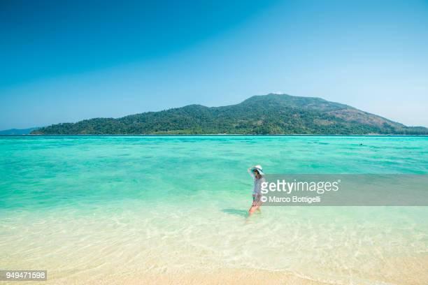 Tourist woman on the beach, Koh Lipe, Thailand