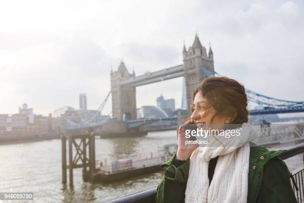 tourist  woman on the phone - emigration and immigration stock pictures, royalty-free photos & images