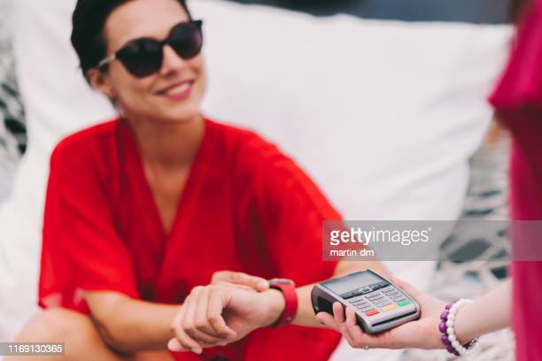 Tourist woman paying contactless on vacation