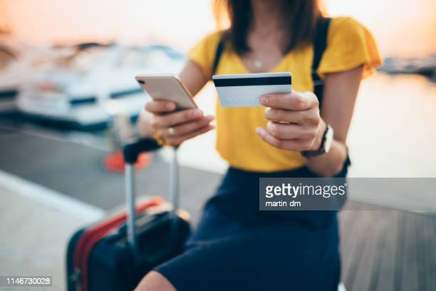 tourist woman paying online with credit card - save the date stock pictures, royalty-free photos & images