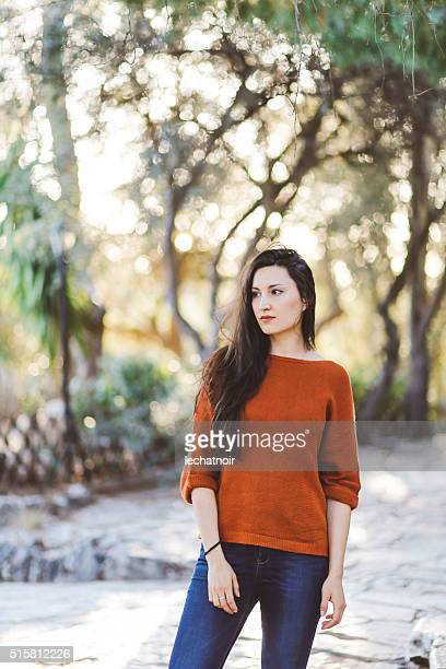 Tourist woman posing in the park in Athens, Greece