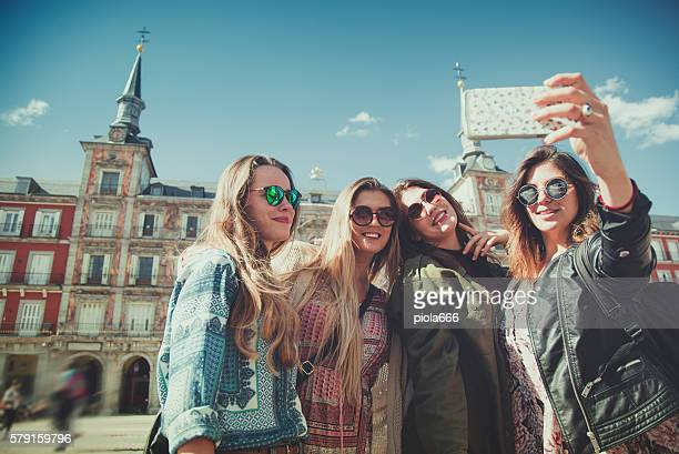tourist woman selfie in plaza major, madrid - madrid stock-fotos und bilder