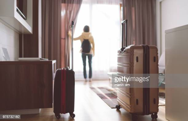 tourist woman staying in luxury hotel - turista foto e immagini stock