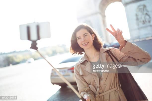 tourist woman take a selfie in paris