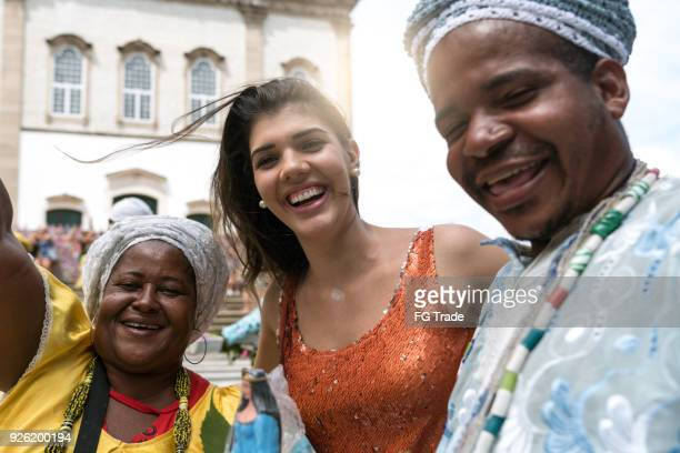 Tourist Woman Taking a Selfie With Local Brazilian Religious People