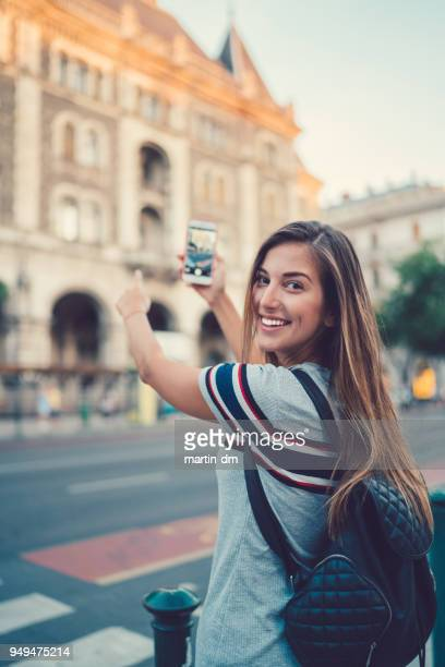 tourist woman taking photos in europe - photo messaging stock pictures, royalty-free photos & images