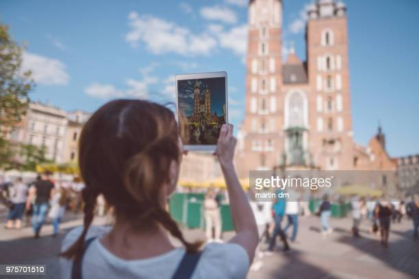 tourist woman traveling in europe,photographing and vlogging during summer - malopolskie province stock pictures, royalty-free photos & images
