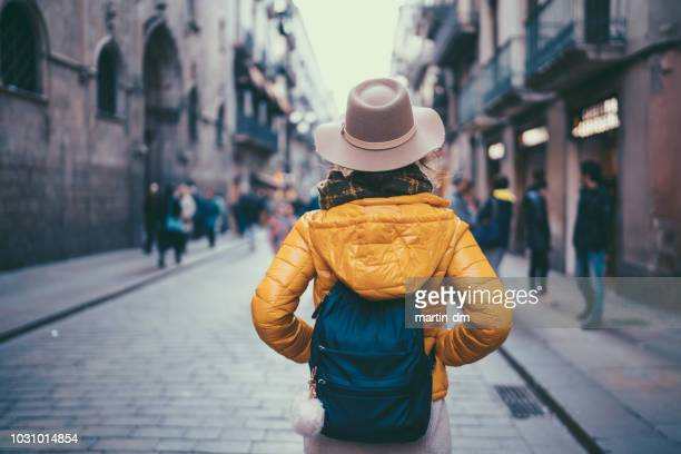 tourist woman visiting spain - rear view photos stock photos and pictures