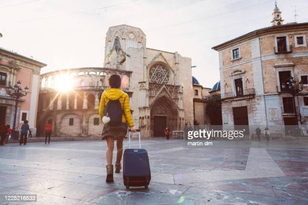 tourist woman visiting valencia, plaza de la virgen - valencia spain stock pictures, royalty-free photos & images