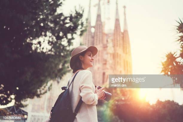 tourist woman with camera exploring bracelona - barcelona spain stock pictures, royalty-free photos & images