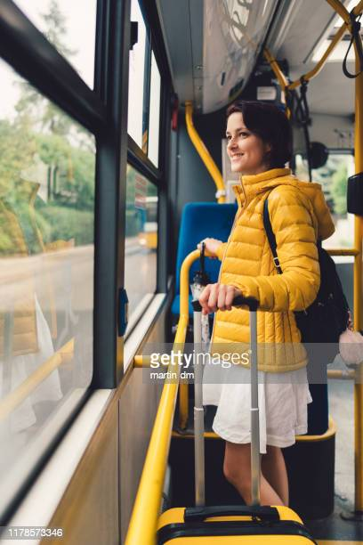 tourist woman with suitcase traveling in bus - jacket stock pictures, royalty-free photos & images