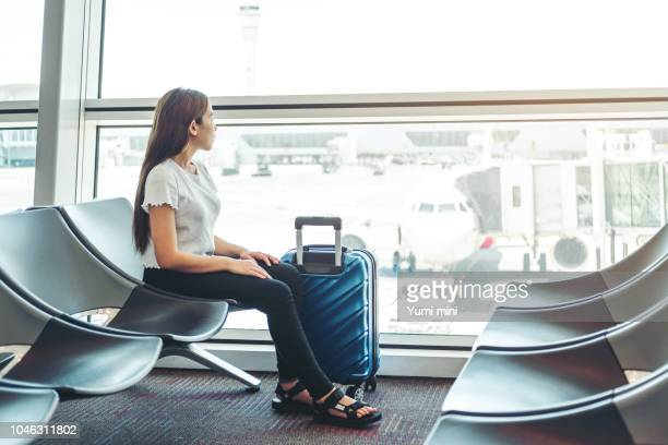 Tourist Women at international airport waiting for boarding