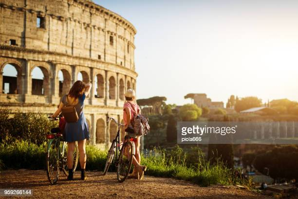 tourist women in rome: by the coliseum - roma stock photos and pictures