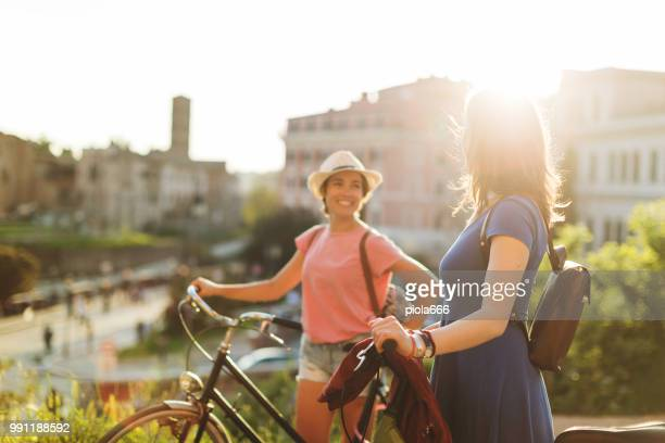 Tourist women in Rome: by the Coliseum