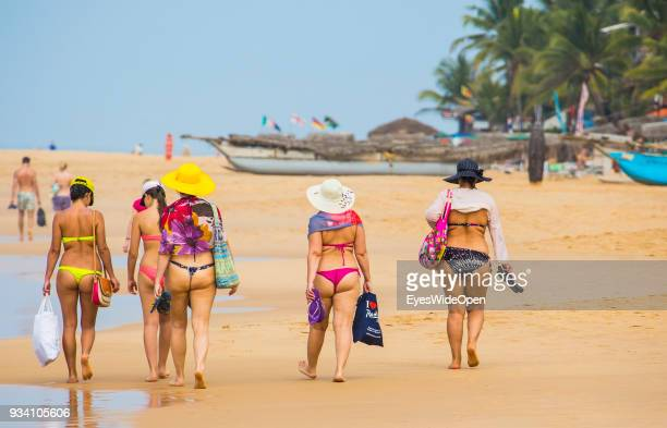 Tourist women in string tangas visit Hikkaduwa Beach in the southouest coast for sightseeing surfing sunbathing and shopping on March 03 2014 in...