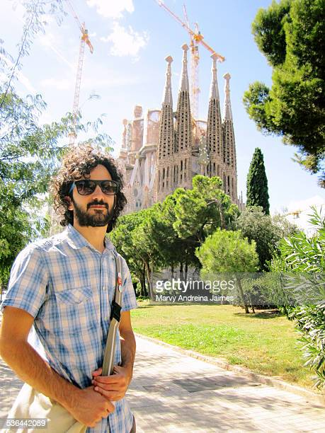 Tourist young man in front of Sagrada Familia