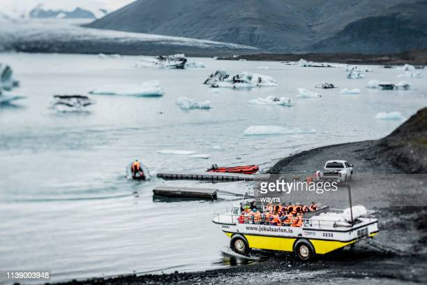 touristic amphibian boat trip on jokulsarlon glacier lagoon - breidamerkurjokull glacier stock photos and pictures