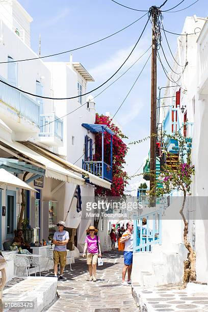 Touristic street in Mykonos town, Greece, going between traditional white buildings