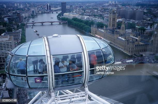 tourists aboard the london eye - victoria tower stock pictures, royalty-free photos & images