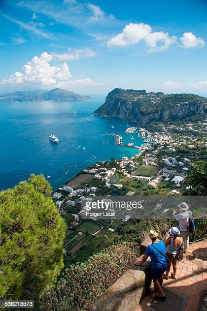 Tourists admire Marina Grande view from Anacapri
