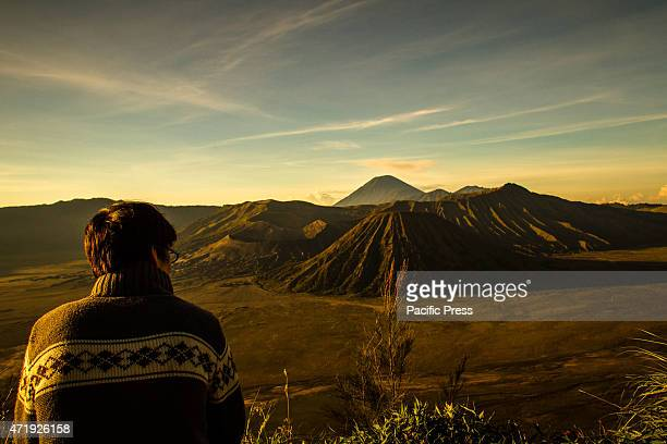 Tourists admire the magnificent views of Mount Bromo, the spectacular volcanic peak that is situated high up in the Tengger mountains.