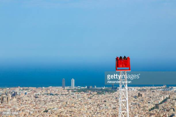 tourists admiring barcelona from above, barcelona, catalonia, spain - tibidabo stock pictures, royalty-free photos & images