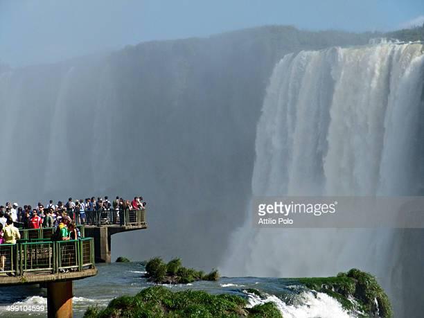 Tourists admiring the majestic Iguazu falls, Brazil/Argentina border.