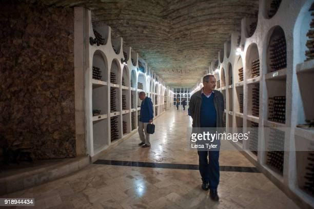 Tourists admiring the wine cellars of Cricova Winery, Moldovas second largest wine cellar with over 120km of underground roadways.