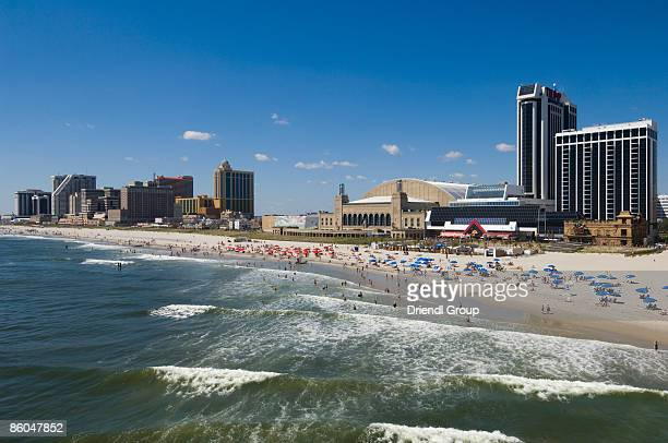 tourists along the beach and boardwalk. - atlantic city stock pictures, royalty-free photos & images