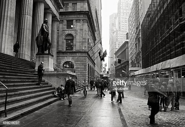 Tourists along Wall Street at Federal Hall, Lower Manhattan, NYC