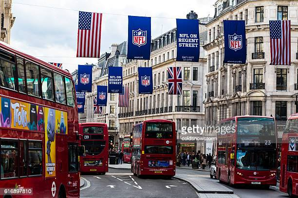 Tourists and buses Regent Street, London, with NFL flags