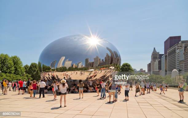 tourists and chicago bean - millenium park stock photos and pictures