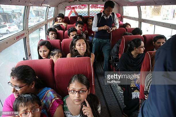 Tourists and citizen in a bus in Katmandu Nepal on 26 August 2016 As the roads are dangerous there are many fatal accidents every week as the routes...