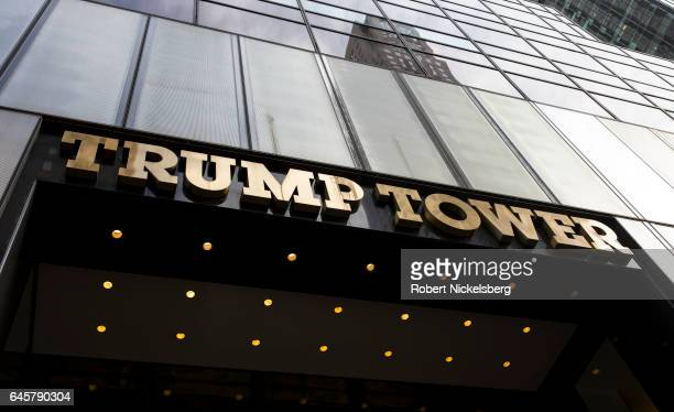 Tourists and curiosity seekers visit Trump Tower February 25 2017 along Fifth Avenue in New York City The 58story luxury condominium building has...