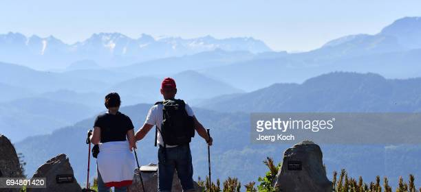Tourists and daytrippers enjoy the sunny weather on the mountain 'Kampenwand' on June 11 2017 near Aschau im Chiemgau Germany Summer weather of blue...