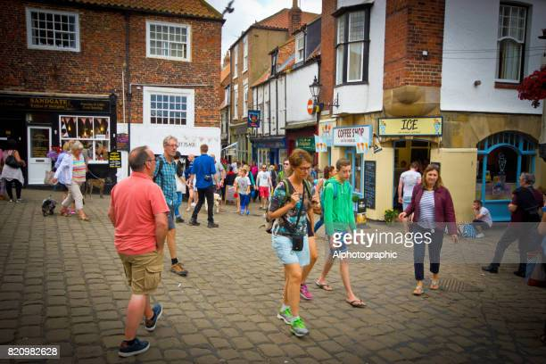 tourists and dog walkers in whitby - stoking stock pictures, royalty-free photos & images