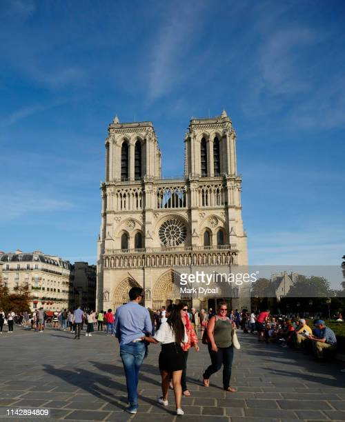 tourists and families visiting our lady of paris! - mark dyball stock photos and pictures