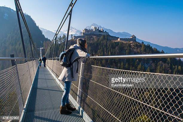 Tourists and hiker visit the sightseeing point of Castle Ehrenberg which has the longest Tibetstyle suspension bridge in the world on March 20 2015...