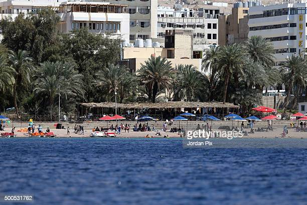 Tourists and Jordanians enjoy the sun and sea during the weekend on April 4 2015 in the southern city of Aqaba Jordan Jordan tourism stakeholders had...