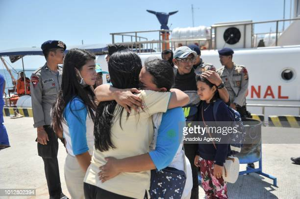 Tourists and local residents evacuated from Gili Trawangan arrive at Bangsal Harbor North Lombok Indonesia on August 7 2018 A 70 magnitude quake hit...