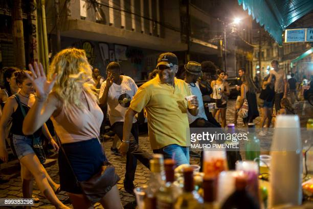 Tourists and locals dance funk music in the area of Quilombo Pedra do Sal in downtown Rio de Janeiro Brazil on December 18 2017 In Rio de Janeiro...
