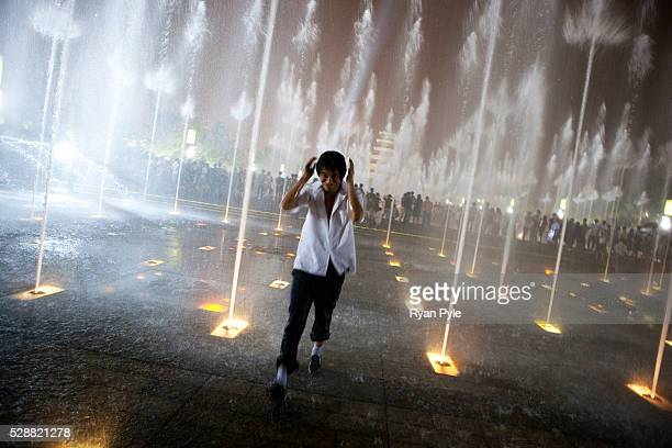 Tourists and locals enjoy a music light and water show in front of the Big Goose Pagoda in Xian Xian is one of China's oldest cities and was the...