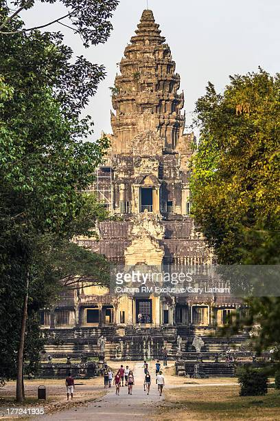Tourists and locals, just after sunrise at Angkor Wat Temple, East Gate, Siem Reap, Cambodia