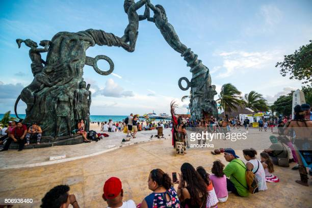 tourists and locals looking at entertaining show in fundadores park, playa del carmen, mexico - mayan riviera stock photos and pictures